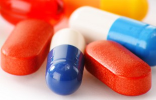 Composition with variety of drug pills and dietary supplements.