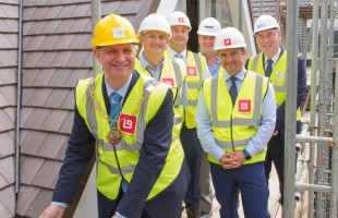 Cllr Andrew Eyre joins representatives from Care UK and Lawrence Baker to place the final tile on new Sevenoaks care home