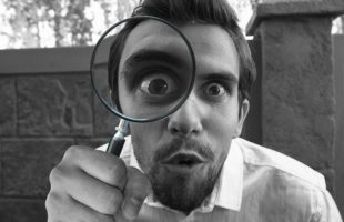 man with magnifying glass | UK Care Home Industry News