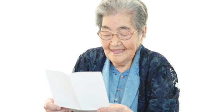 Old lady receives letter in 1 Letter 1 Smile initiative