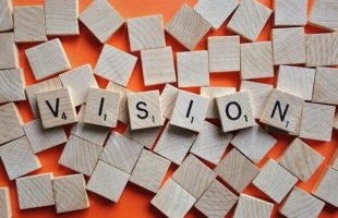 vision spelt out in wooden scrabble pieces | UK Care Home Industry News