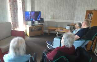 care home residents watching tv | Nursing Home Management