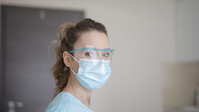 Woman in PPE | Care Home Professional News