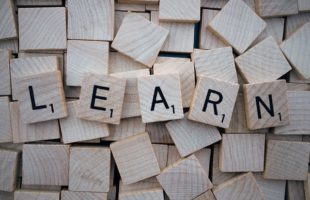 Learn spelt in wooden scrabble pieces | Care Home Agency Advice