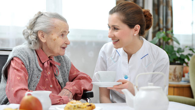 Care home staff and resident tea | Nursing Home News