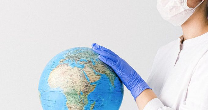 Care worker holding globe | Professional Care Home Advice
