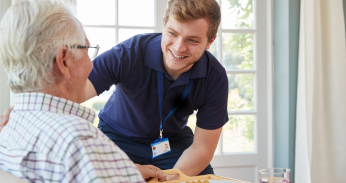Care staff with resident | Care Home Information