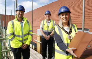 Care UK Topping Out ceremony at their new site Dashwood Manor, The Island Site, Kempshott in Basingstoke. L to R David Gannon (Care UK Head of Acquisitions), Jim Faulkner (Highwood Site Manager) and Basingstoke Mayor Cllr Diane Taylor.
