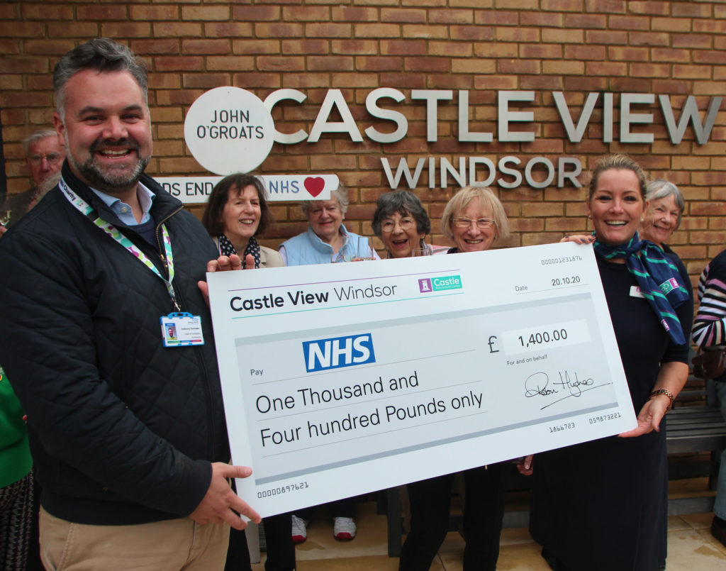 Residents and staff at Castle View Windsor holding cheque