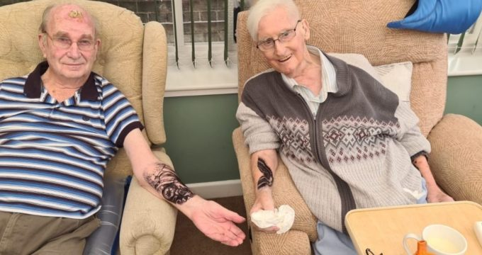 Residents modelling their temporary tattoo