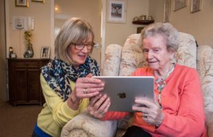 care home resident using ipad | Nursing Home Agency Advice