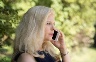 lady speaking on a mobile phone | Care Home Management Podcast