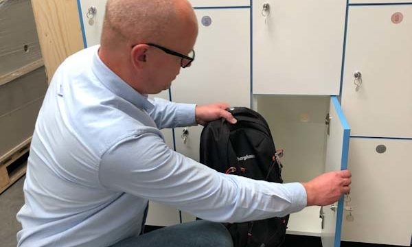 Man placing rucksack in locker | Residential Care Management
