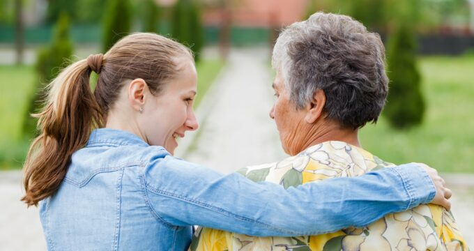 young carer and elderly woman | Care Home Management
