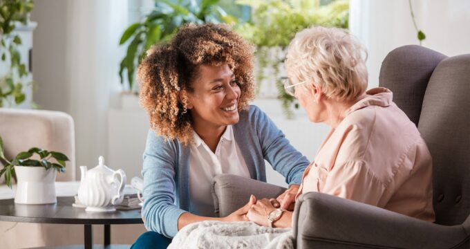 care staff looking after care home resident | Care Home Advice