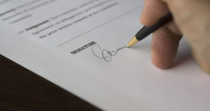 Signing a document | Care Home Management