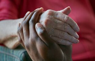 holding hands | Care Home Professional News