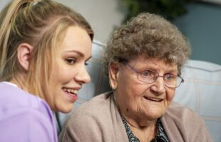 Resident and member of staff in care home | Care Home Management