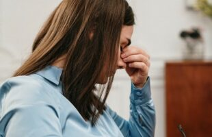 Woman looking stressed | Care Home Information