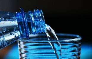 pouring water into glass | Nursing Home Information