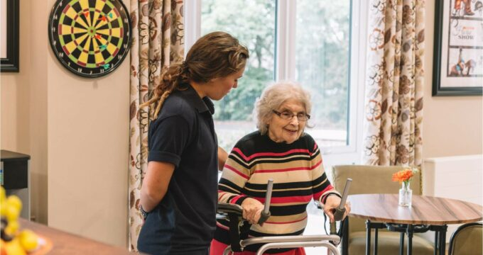 care home resident using walker with care assistant   Care Home Information