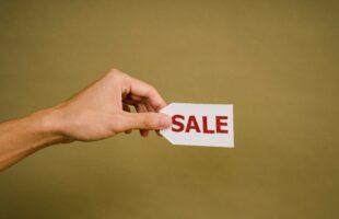 Hand holding sale tag | Nursing Home Advice