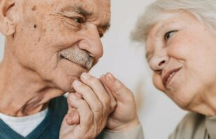 Elderly couple holding hands | Care Home Supplier News