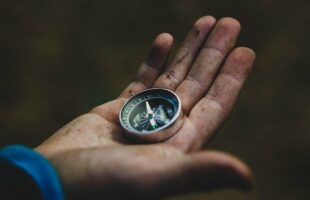 hand holding compass | Professional Care Home Advice