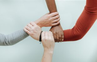hands holding each others arms | Care Home Supplier News