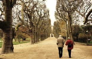 two people walking outdoors | Care Home Providers Guidance
