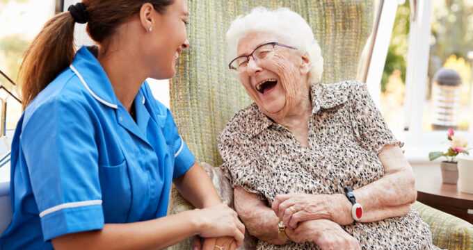 carehome nurse and elderly woman laughing | Professional Care Home Advice