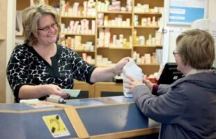 pharmacist serving a customer   Care Home Providers Guidance