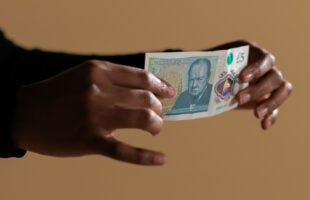 hands hold £5 note | Care Home Information