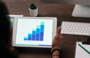 person holding a tablet with a graph | Nursing Home Advice